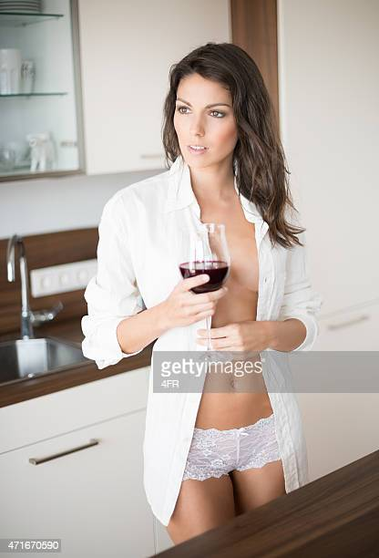 Beautiful Woman enjoying a Glas of Wine in Lingerie