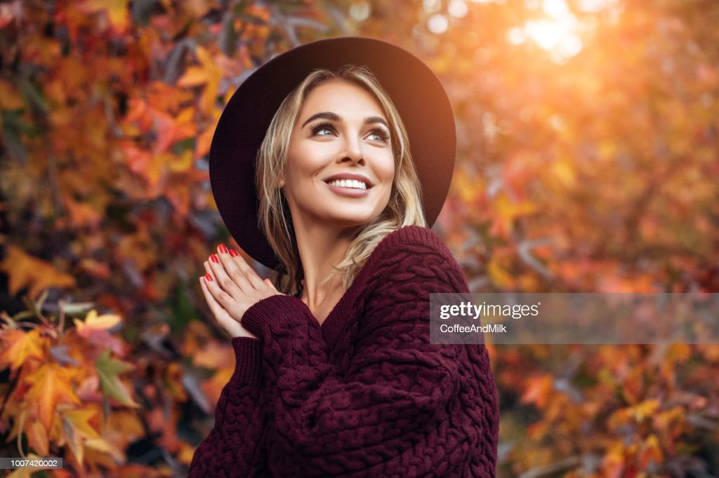 Beautiful woman enjoying in a sunny autumn day : Stock Photo