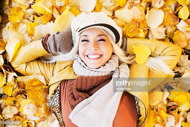 Beautiful woman enjoying in a sunny autumn day