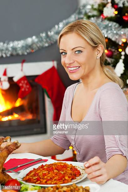 beautiful woman enjoying in christmas dinner. - one mid adult woman only stock pictures, royalty-free photos & images