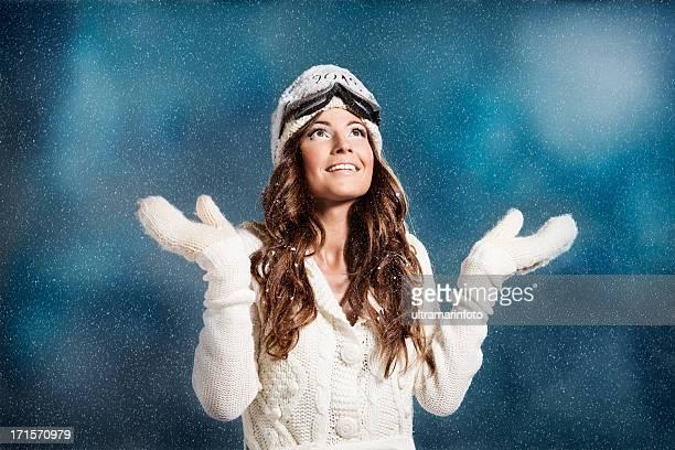 Beautiful woman enjoying in snow