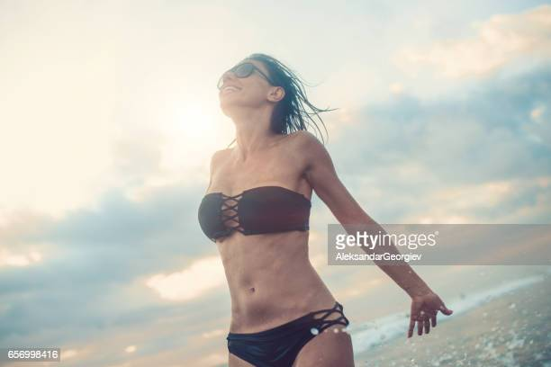Beautiful Woman Enjoying Sea Waves and the Wind