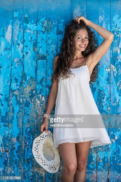 beautiful woman enjoying summer vacations - blue dress stock pictures, royalty-free photos & images