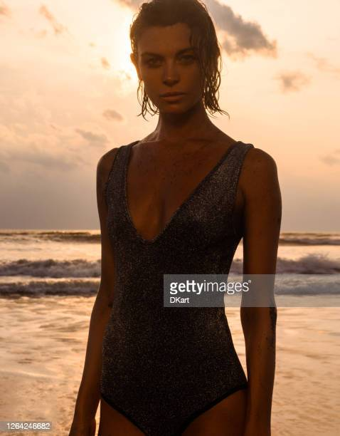 beautiful woman enjoying sun on the beach - beautiful female bottoms stock pictures, royalty-free photos & images