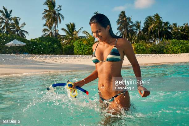 beautiful woman enjoying the turquoise water - hot latina women stock photos and pictures