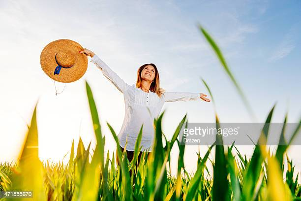 beautiful woman enjoys summer nature and freedom in wheat fields - drazen stock pictures, royalty-free photos & images