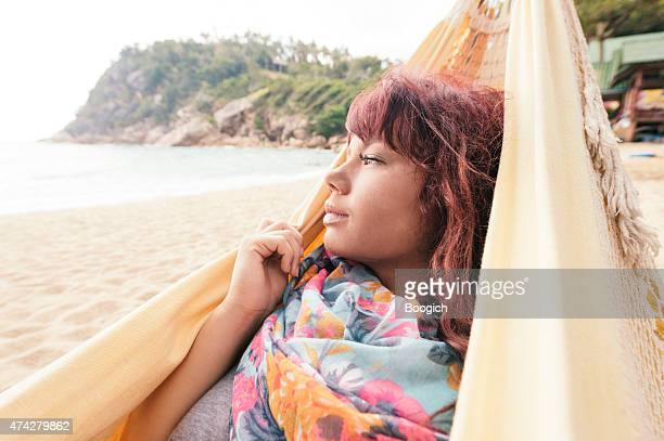 Beautiful Woman Enjoys View from Hammock on Tropical Thailand Beach