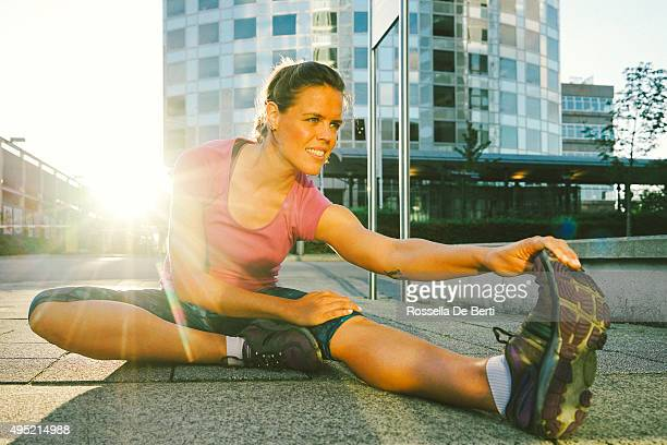 Beautiful Woman Exercising Outdoors In The Early Morning