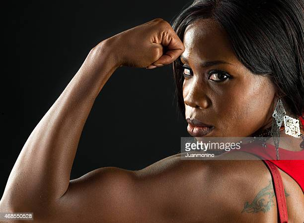 beautiful woman flexing - black female bodybuilder stock photos and pictures