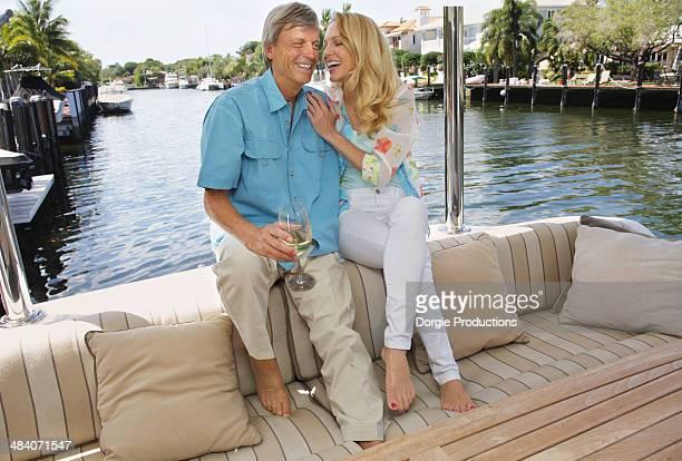 Beautiful woman flirting with man on a yacht
