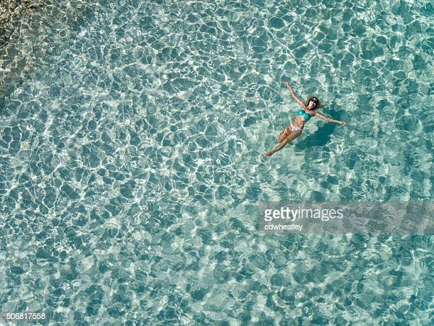 beautiful woman floating in tropical water