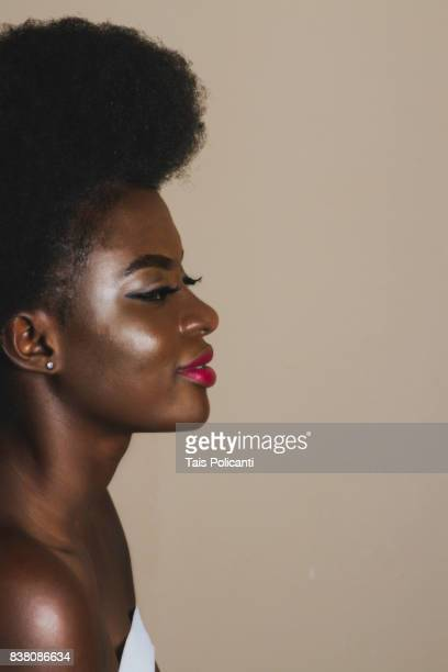 Beautiful Woman from Ghana with an afro hairstyle - studio shooting