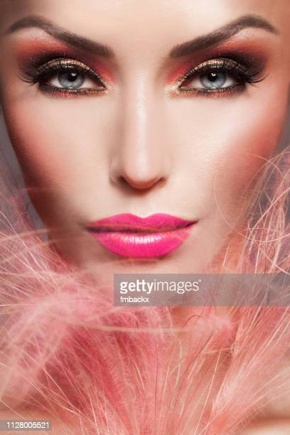 beautiful woman frontal make-up close-up with pink feathers - pink lipstick stock pictures, royalty-free photos & images