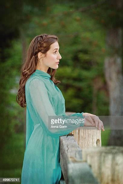 beautiful woman gazing into distance - 長袖 ストックフォトと画像