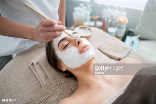 Beautiful woman getting a facial at the spa