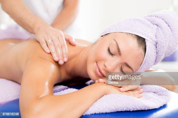 beautiful woman getting back massage - human back stock pictures, royalty-free photos & images