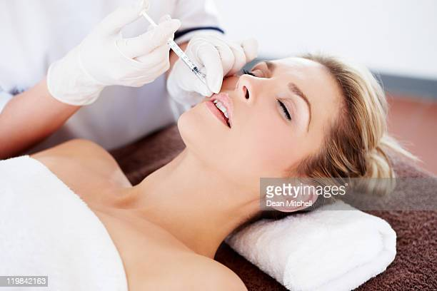 beautiful woman getting botox injection
