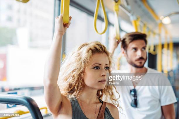 Beautiful woman going to work by public bus
