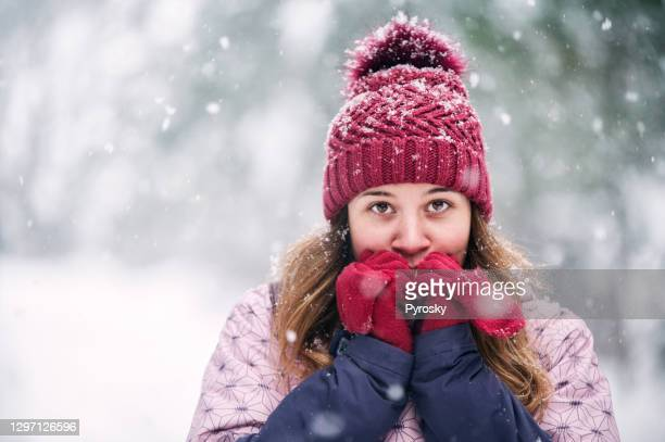 beautiful woman heating up her hands - fingerless gloves stock pictures, royalty-free photos & images