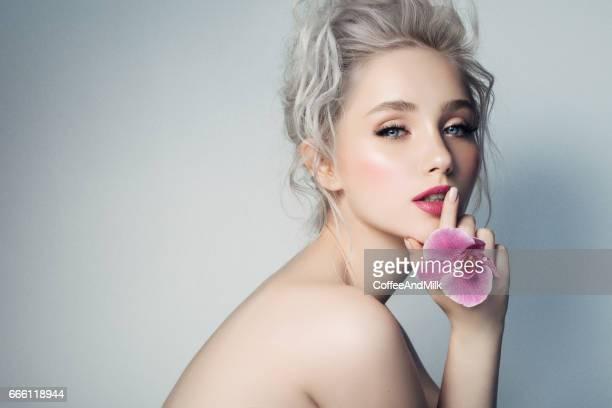 Beautiful woman holding a flower