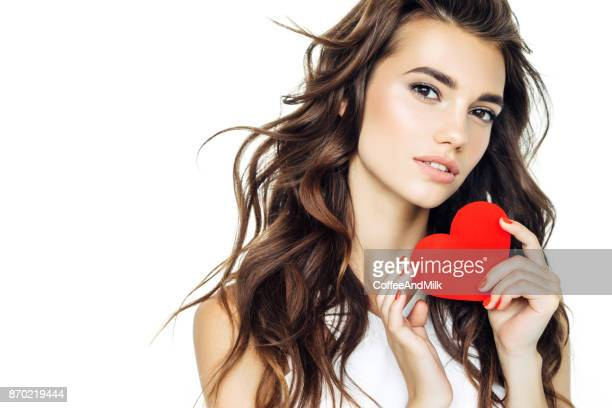 beautiful woman holding artificial heart - hair love stock pictures, royalty-free photos & images