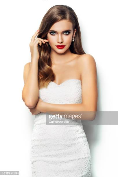 beautiful woman holding artificial heart - cut out dress stock pictures, royalty-free photos & images