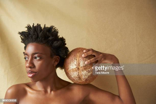 beautiful woman holding bread - black sexual stock photos and pictures