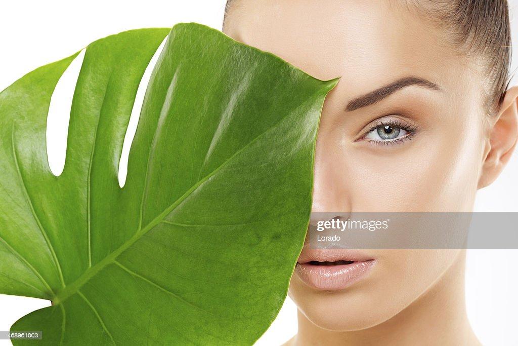 beautiful woman holding green leaf : Stock Photo