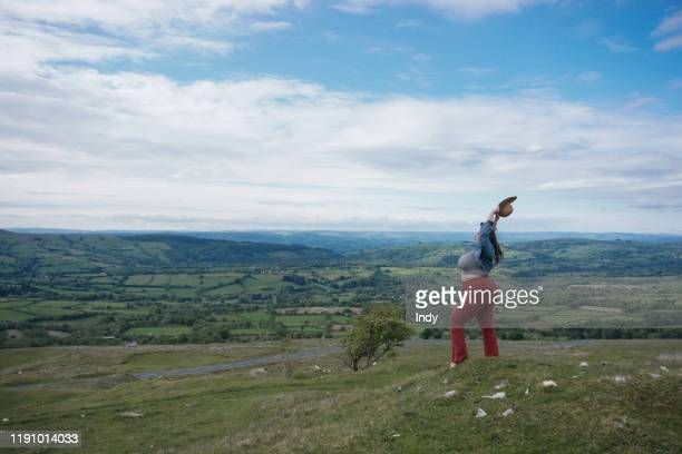 beautiful woman holding her arms in the air, black mountains, powys, snowdonia, wales, uk - overweight stock pictures, royalty-free photos & images