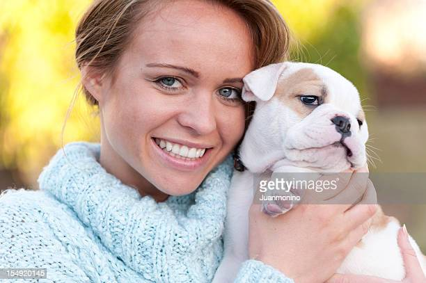 Beautiful woman holding her dog