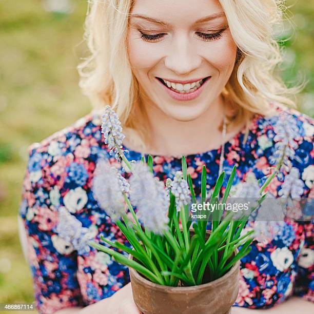 Beautiful woman holding spring flower