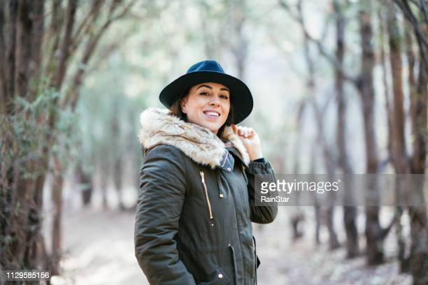 beautiful woman in a autumn day - long coat stock pictures, royalty-free photos & images