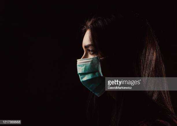 beautiful woman in a blue mask - epidemic stock pictures, royalty-free photos & images