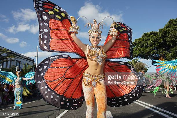 CONTENT] A beautiful woman in a butterfly cosutme at the Carnival of Santa Cruz de Tenerife Tis Carnival is held in Santa Cruz de Tenerife the...