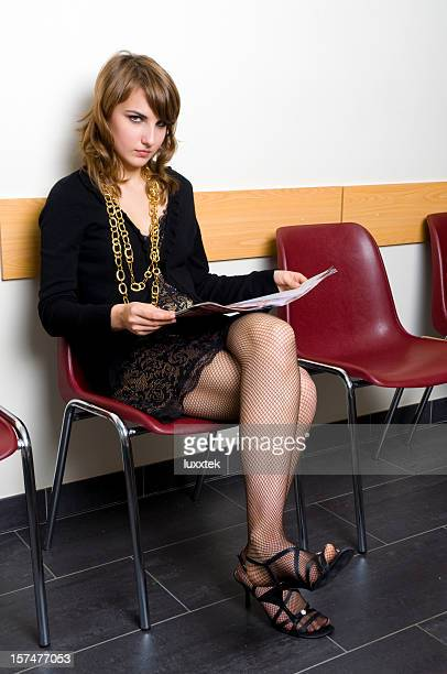 beautiful  woman in a medical practise  waiting room - teen pantyhose stock photos and pictures