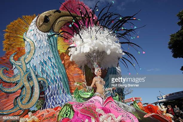 CONTENT] beautiful woman in a sexy costume on carnival float at parade in Santa Cruz de Tenerife