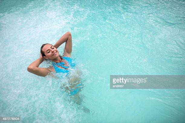 beautiful woman in a swimming pool - hydrotherapy stock photos and pictures