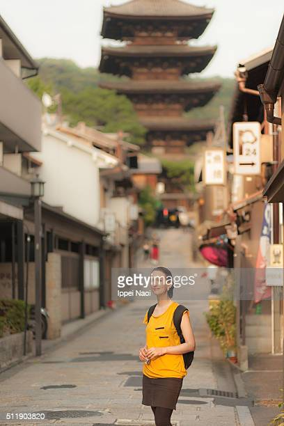 Beautiful woman in a traditional alley in Kyoto