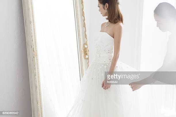 Beautiful woman in a wedding dress.