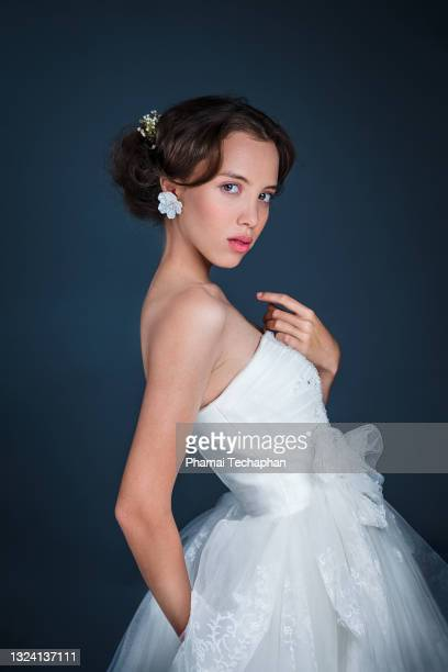 beautiful woman in a white gown - evening gown stock pictures, royalty-free photos & images