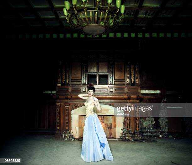 Beautiful woman in an old house
