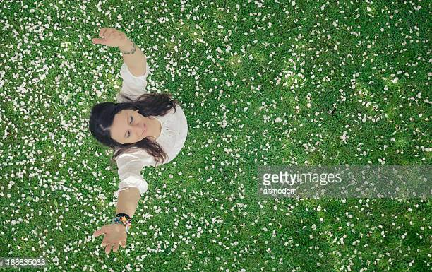 Beautiful woman in apple blossoms