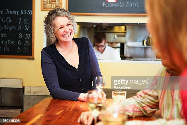 Beautiful Woman in Bar or Restaurant Laughing