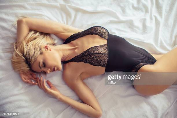 beautiful woman in bedroom - frilly stock photos and pictures