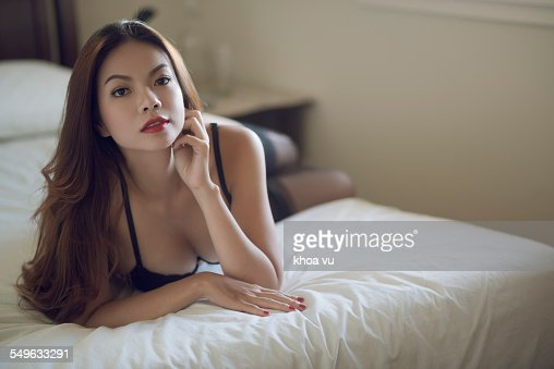 Beautiful Woman In Black Lingerie Waiting On Bed Stock Photo  Getty Images-5503