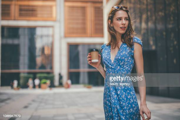 beautiful woman in blue dress - dress stock pictures, royalty-free photos & images