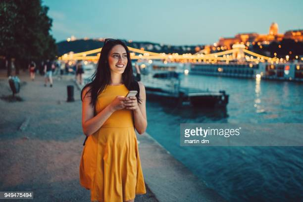 beautiful woman in budapest using phone - hungary stock pictures, royalty-free photos & images