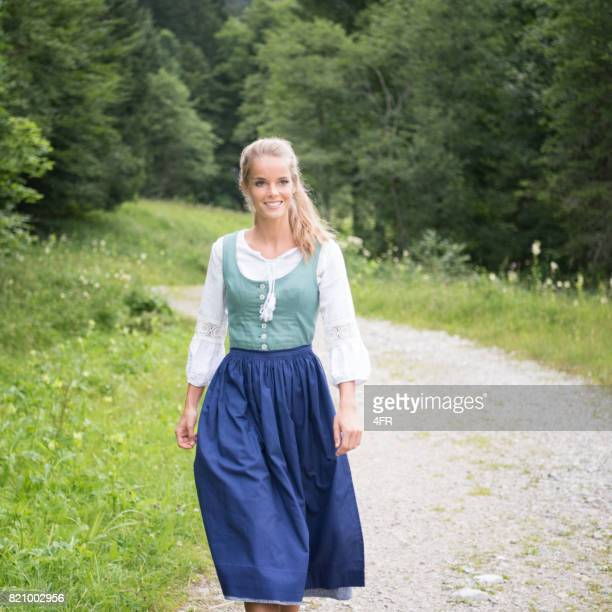 beautiful woman in dirndl costume, austria - traditional clothing stock pictures, royalty-free photos & images