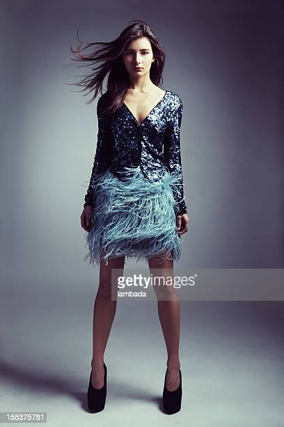 beautiful woman in fashionable clothes - wind blows up skirt stock pictures, royalty-free photos & images