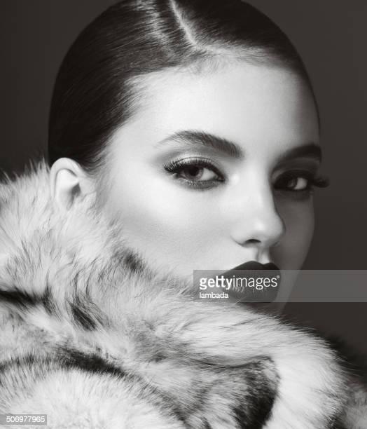 Beautiful woman in fur coat